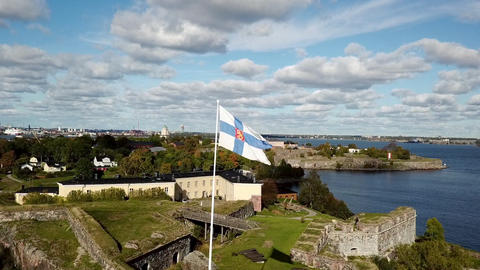 Patriotic concept Finland flag flutters at background peaceful seascape and town Live Action