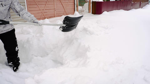 Man trow snow with shovel Live Action