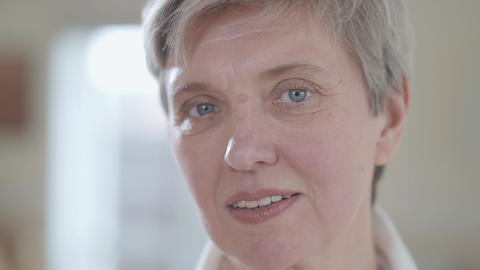 Close up portrait of senior woman looking in camera with... Stock Video Footage
