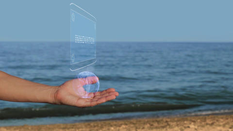 Male hands on the beach hold a conceptual hologram with the text Innovation Footage