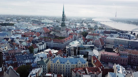 Modern town in Latvia with wealth medieval heritage riverside top view landscape Live Action