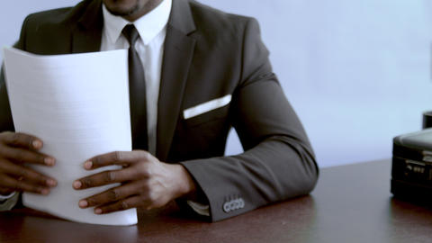 Businessman gives a documents for the work visa, holding banking paper Footage