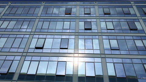 Office building windows reflecting blue sky and flying plane Footage