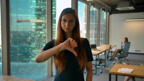 Get dislike. Thumbs Down by Beautiful Female Sitting Indoor Footage