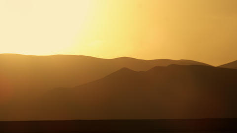 Stock Video Footage of a sunset with silhouetted mountains shot in Israel at 4k  Footage