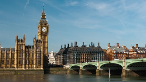 Time-lapse of traffic crossing Westminster Bridge by Houses of Parliament in Lon Footage