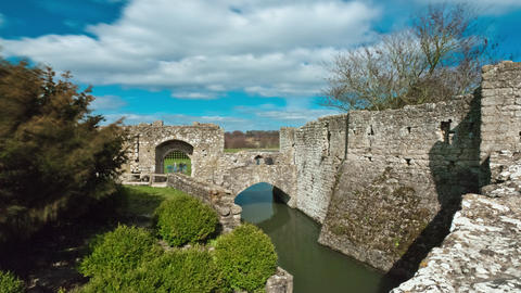 Time-lapse as clouds pass over an entrance to Leeds castle Footage