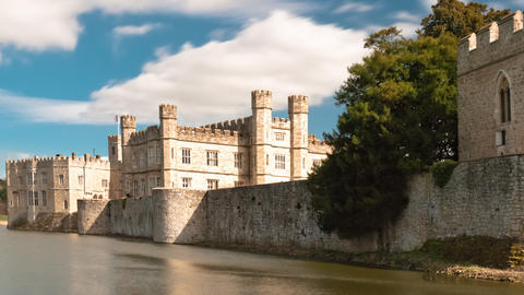 Time-lapse of exterior of Leeds Castle and moat in England Footage