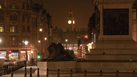 Big Ben and a lion statue in a night time-lapse shot in London Footage