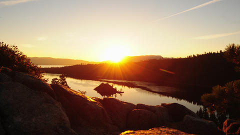 Timelapse shot of the sunrise seen over Emerald Bay and Nevada desert with lens  Footage