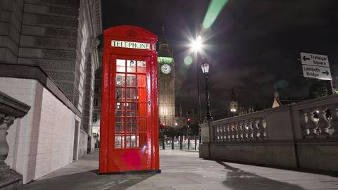 Tracking time-lapse of Big Ben behind a telephone booth in London Footage