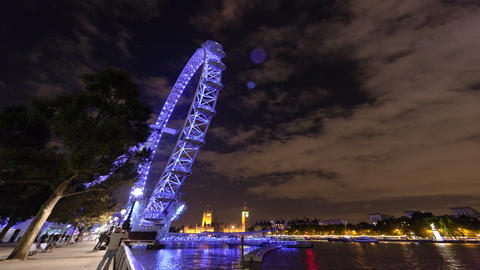 Wide angle time-lapse of the London Eye Ferris Wheel at night Footage