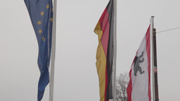 Flags of Germany and the European union waving in the wind Footage