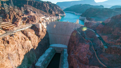 Timelapse aerial shot of Hoover Dam with lens flare Footage