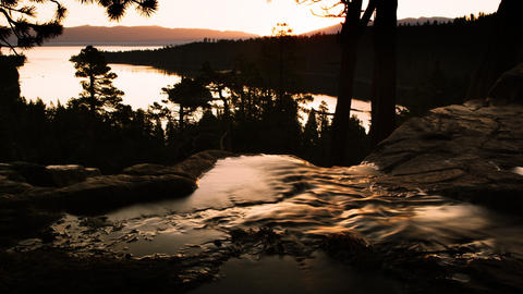 Dusk shot of stream running into river above Emerald Bay, Lake Tahoe, California Footage