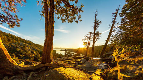 Tilting shot of the sunrise over Emerald Bay in Nevada with lens flare Footage