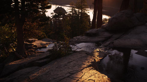 Dusk shot of stream surrounded by trees above Emerald Bay, Lake Tahoe, Californi Footage