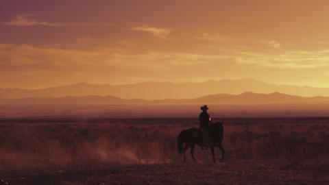 Slow motion shot of a cowboy riding a horse Footage