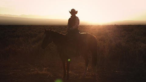 Static shot of a cowboy sitting on a horse Footage