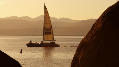 Static shot of sailboat gliding in front of mountain. Emerald Bay State Park, La Footage