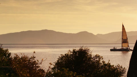 Static shot of sailboat and landscape. Shot at Emerald Bay State Park, Lake Taho Footage