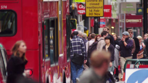 LONDON - OCTOBER 8: Bus passes a crowded street on October 8, 2011 in London Footage