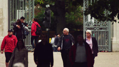 LONDON - OCTOBER 8: Unidentified people by gates on October 8, 2011 in London Footage