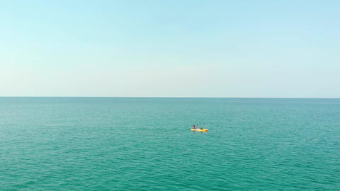 Two Men are Kayaking in the Sea Footage