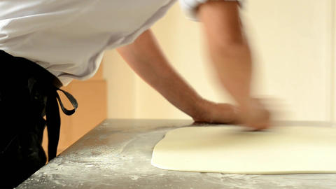 Confectioner using rolling pin preparing fondant for cake decorating Footage