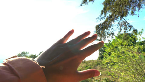 Expressing delighed emotions. Inspirational. Grasping the sun with palm/fingers Footage