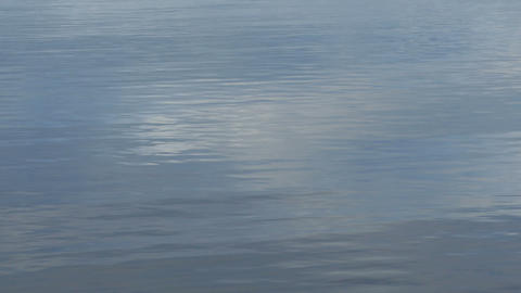 clouds reflected on rippled water Footage