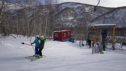 Ski lift moving up skiers to snow mountain slope ski resort Archivo