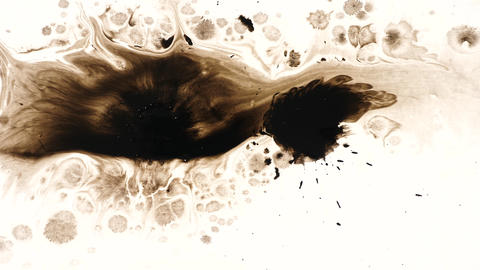 Drops of ink spilling in water over a white background Live Action