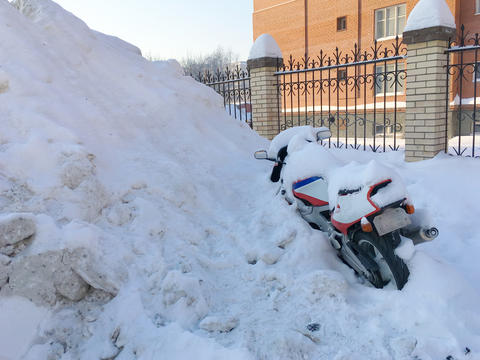 Motorcycle frozen in snow Photo