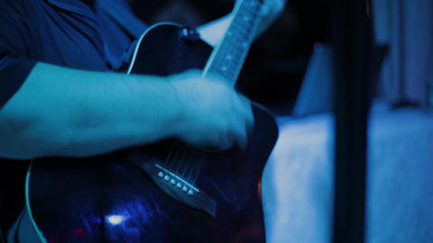 Man playing the guitar,practicing in playing guitar, handsome young men playing Live Action