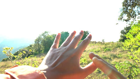 Expressing delighed emotions. Inspirational. Couple hands grasping the sun Footage