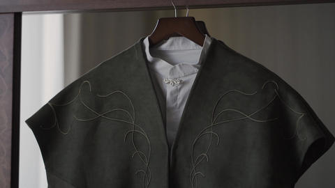 A man's jacket hangs on a hanger in the room Live Action