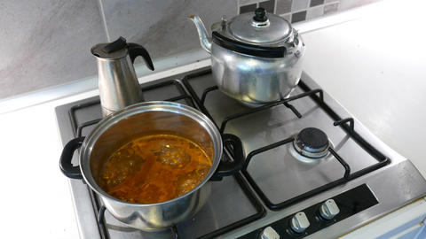 4K Metal Dishes in Kitchen and Boilng Instant Soup Stock Video Footage