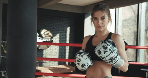 Portrait kickboxing woman fighter looking confident at camera tough female Footage