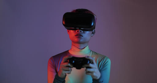 Female gaming with VR headset and game console Footage