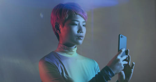 Asian female using smart phone in futuristic environment Live Action