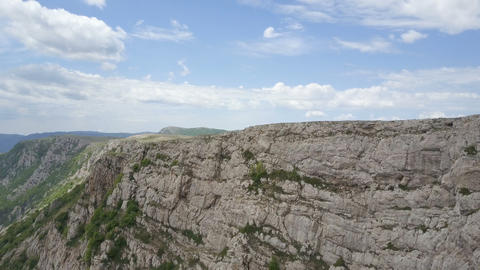 Amazing Aerial view of rocks, forests and sea in Crimea. Flight along a cliff in Live Action