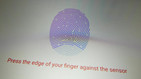 4K Setting Up Fingerprint Code on Tablet Stock Video Footage