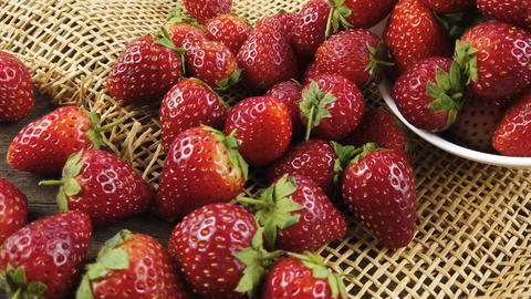 Fresh strawberries on sack cloth Stock Video Footage