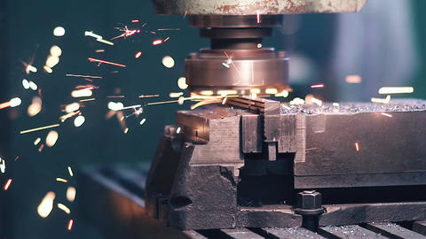 Work milling machine. Slow motion. Sparks from the metal during its processing Footage
