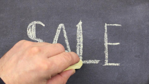 Word SALE is written in chalk on a blackboard. Stroke along the contour with Footage