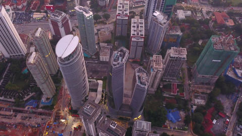 Aerial view of intersection in Kuala Lumpur Downtown, Malaysia. Financial district and business Live Action