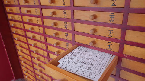 Omikuji - random fortune papers at a Buddhist temple or Shinto Shrine - TOKYO Footage