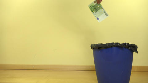 Hand of man throw cash euro money banknotes in can bin. 4K GIF