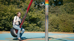 Daughter and Mother on the Outdoor Playground Playing together at Seesaw Footage